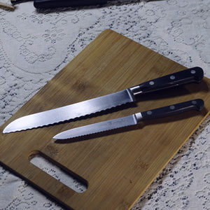 2 J A Henkels int. kitchen knives EUC